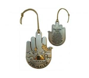 A silver plated Jerusalem and a Dove Hamsa