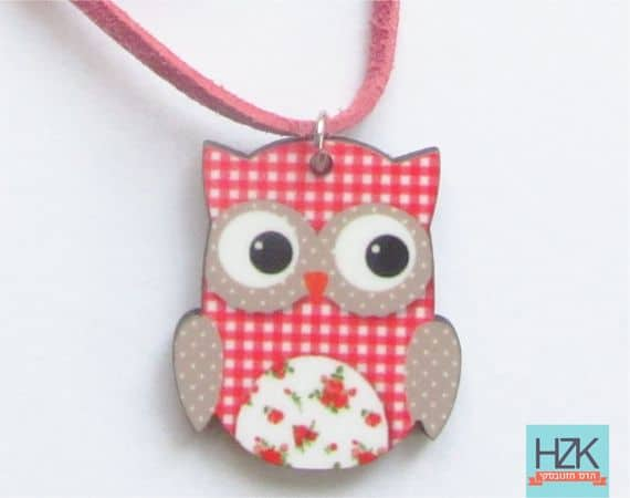 A red owl necklace on a suede string