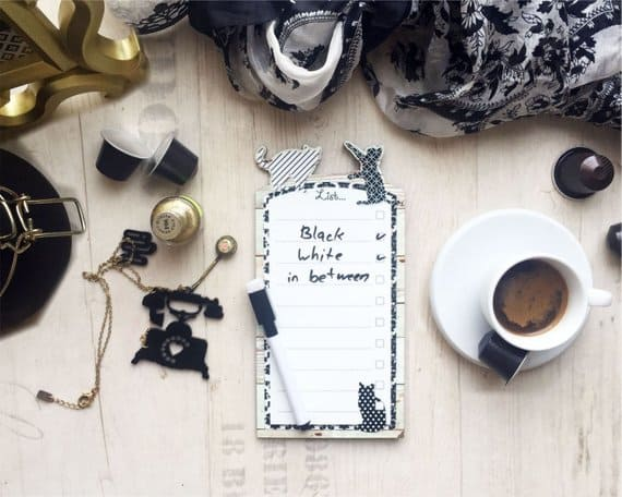 Black and white cats border whiteboard with magnets, To do list board