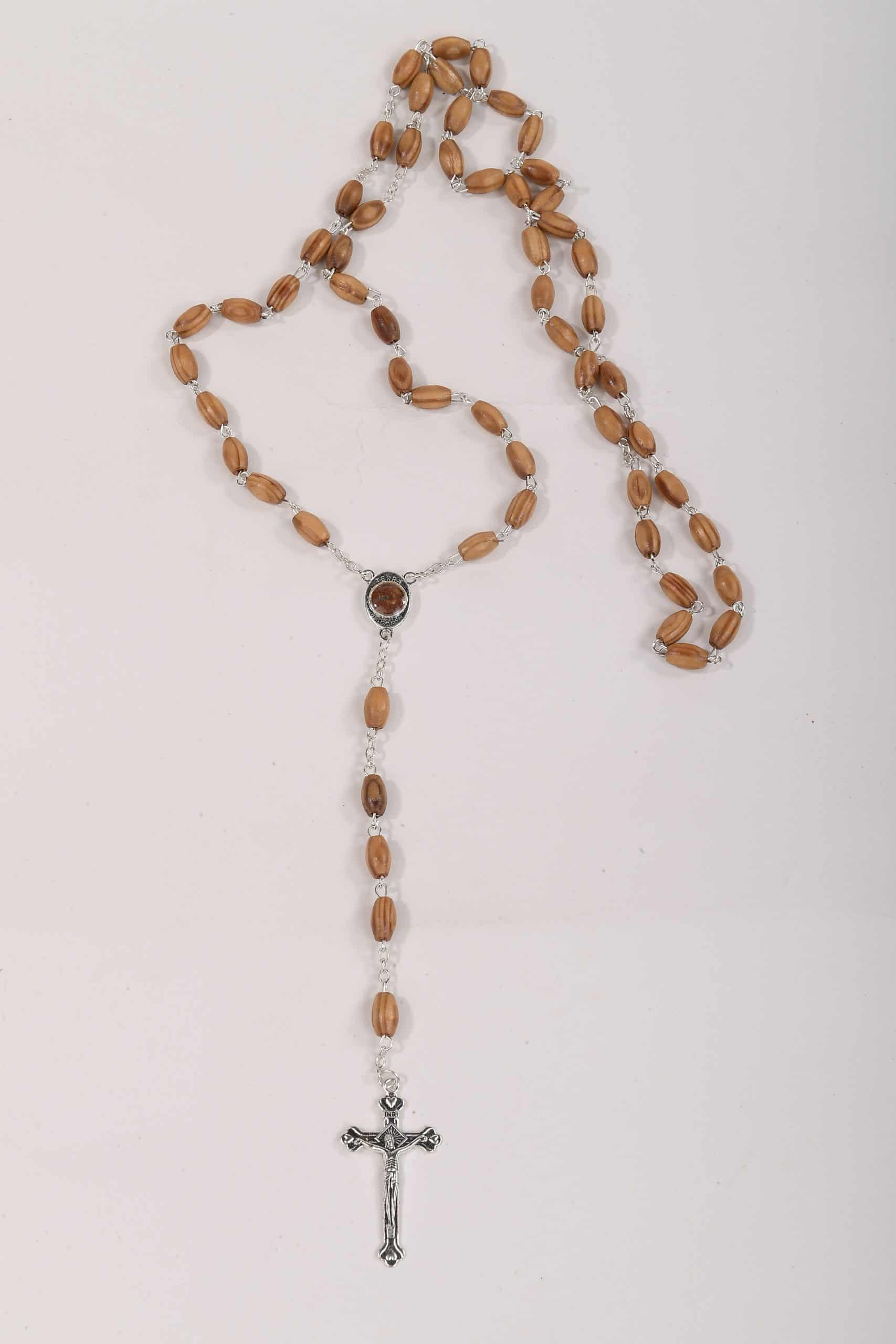 Rosary with holy sands and seeds of olive